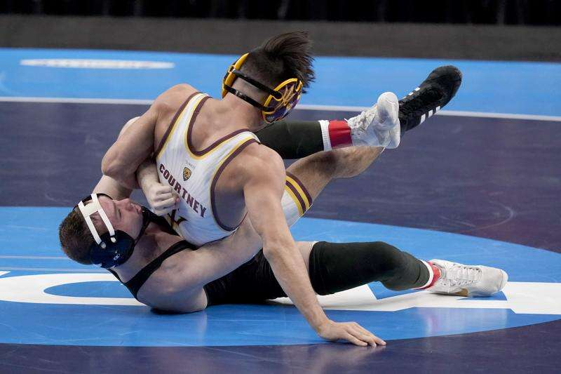 NCAA wrestling takeaways: Iowa's national title, Spencer Lee's latest feat and more