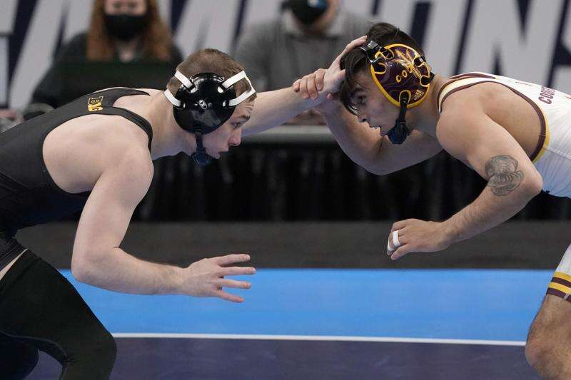 NCAA wrestling notes: Iowa's Spencer Lee grows legendary status with latest national title