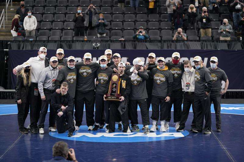 Iowa reclaims NCAA wrestling crown, Spencer Lee overcomes ACL tear to win 3rd title